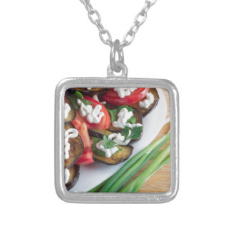 Vegetarian dish of stewed aubergine silver plated necklace