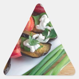 Vegetarian dish of stewed aubergine triangle sticker
