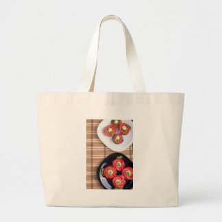 Vegetarian dish of stewed eggplant and fresh tomat large tote bag
