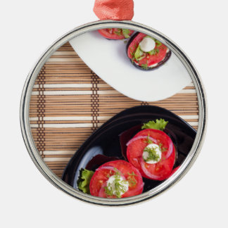 Vegetarian dish of stewed eggplant and fresh tomat Silver-Colored round ornament