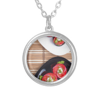 Vegetarian dish of stewed eggplant and fresh tomat silver plated necklace