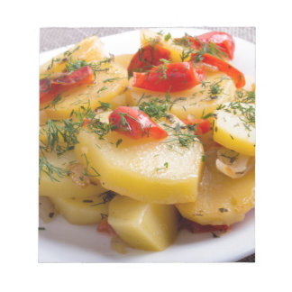 Vegetarian dish of stewed potatoes and bell pepper notepad
