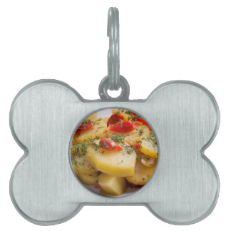 Vegetarian dish of stewed potatoes and bell pepper pet ID tag