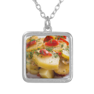 Vegetarian dish of stewed potatoes and bell pepper silver plated necklace