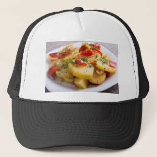 Vegetarian dish of stewed potatoes and bell pepper trucker hat