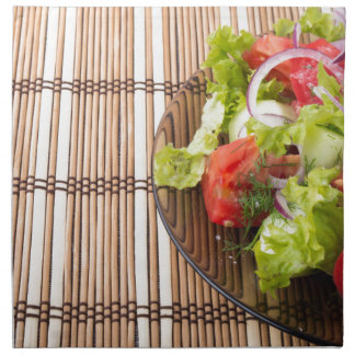 Vegetarian salad from fresh vegetables on a bamboo napkin