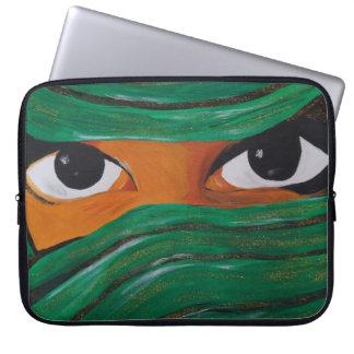 Veiled woman in dark green laptop sleeve
