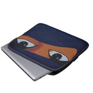 Veiled woman into dark blue laptop sleeve