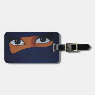 Veiled woman into dark blue luggage tag