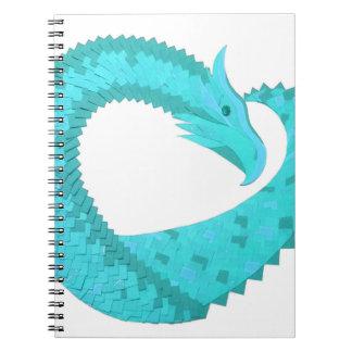 Verdigris heart dragon on white notebook