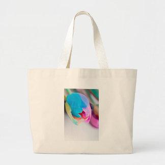 Vertical shoot of unusual multi colored tulip large tote bag