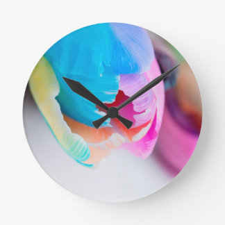 Vertical shoot of unusual multi colored tulip round clock