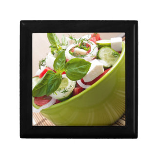 Vertical view close-up on a green bowl with salad keepsake box