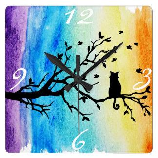 Vibrant Rainbow Watercolor Black Cat in Tree Wall Clocks