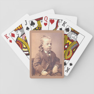 Victorian boy with unfortunate hair style playing cards