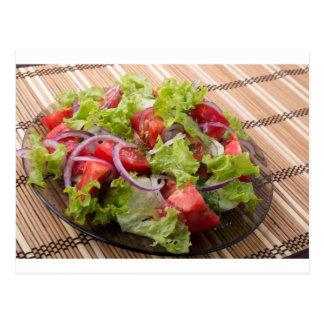View angle on a fragment of vegetarian salad postcard