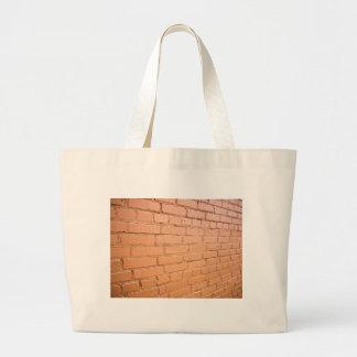 View angle on the brick wall large tote bag