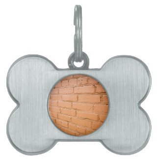 View angle on the red brick wall pet name tag