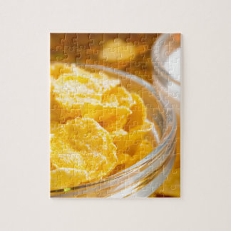 View close-up of milk and a glass bowl of flakes jigsaw puzzle