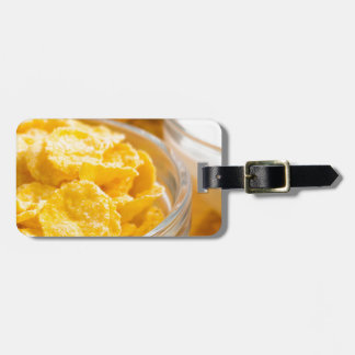 View close-up of milk and a glass bowl of flakes luggage tag