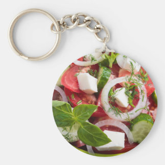 View close-up on a green bowl with a salad basic round button keychain