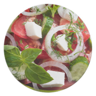 View close-up on a green bowl with a salad dinner plate