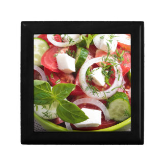 View close-up on a green bowl with a salad keepsake box