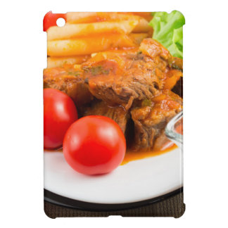View close-up on a meal of beef stew with pasta cover for the iPad mini