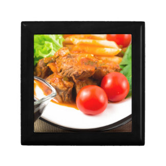 View close-up on a meal of beef stew with pasta keepsake boxes