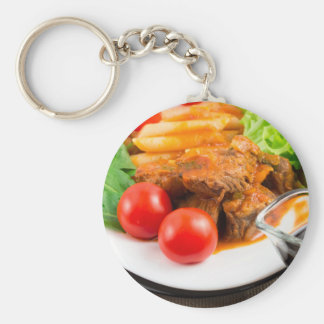View close-up on a meal of beef stew with pasta keychain