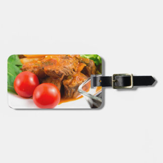 View close-up on a meal of beef stew with pasta luggage tag