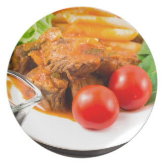 View close-up on a meal of beef stew with pasta plate