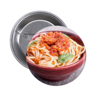 View close-up on a small portion of cooked spaghet 2 inch round button