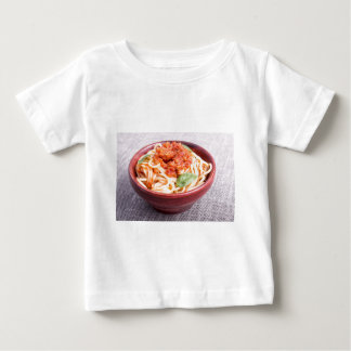 View close-up on a small portion of cooked spaghet baby T-Shirt
