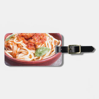 View close-up on a small portion of cooked spaghet luggage tag