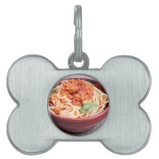 View close-up on a small portion of cooked spaghet pet name tag