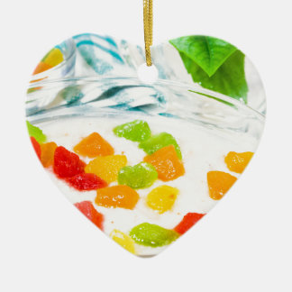 View close-up on oatmeal with colorful candied ceramic ornament