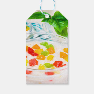 View close-up on oatmeal with colorful candied gift tags