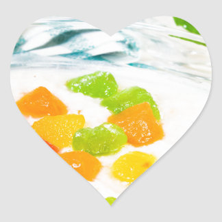 View close-up on oatmeal with colorful candied heart sticker