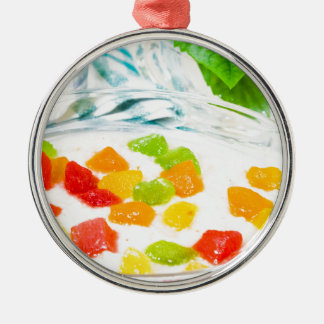 View close-up on oatmeal with colorful candied metal ornament