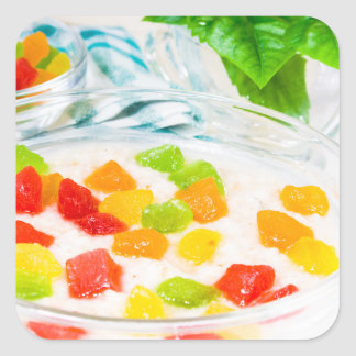 View close-up on oatmeal with colorful candied square sticker
