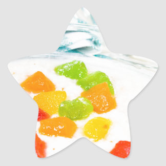 View close-up on oatmeal with colorful candied star sticker