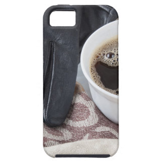View close-up on white cup of coffee and gloves iPhone 5 cover
