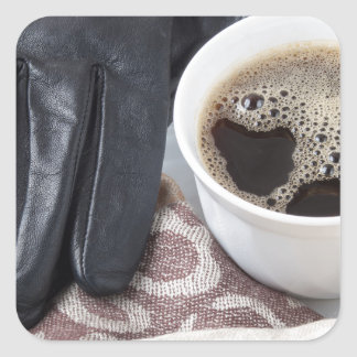 View close-up on white cup of coffee and gloves square sticker