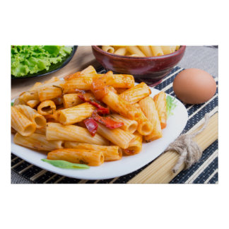View closeup on a dish of rigatoni pasta poster