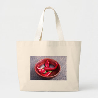 View closeup on hot red chili peppers large tote bag
