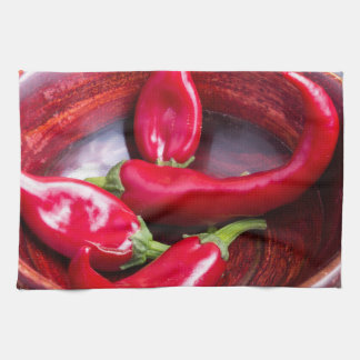 View closeup on hot red chili peppers towel