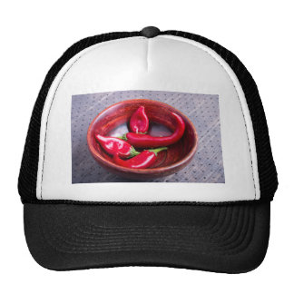 View closeup on hot red chili peppers trucker hat