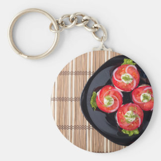 View from above on a dish with fresh sliced tomato basic round button keychain