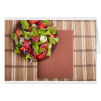 View from above on a plate with fresh salad card